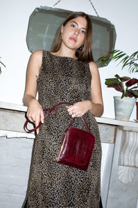 Model wears vintage 1990s leopard-print sleeveless shift dress