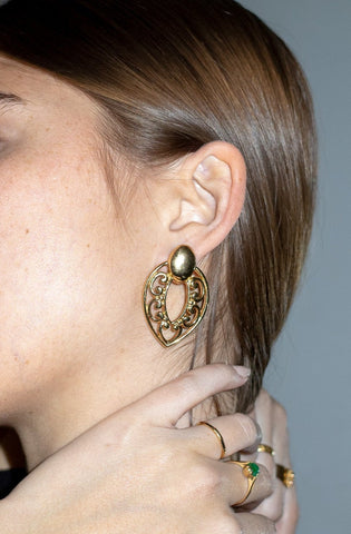 Model wears gold-tone vintage filigree stud earrings