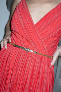 Model wears gold narrow waist belt over vintage red dress by Human Sea Vintage