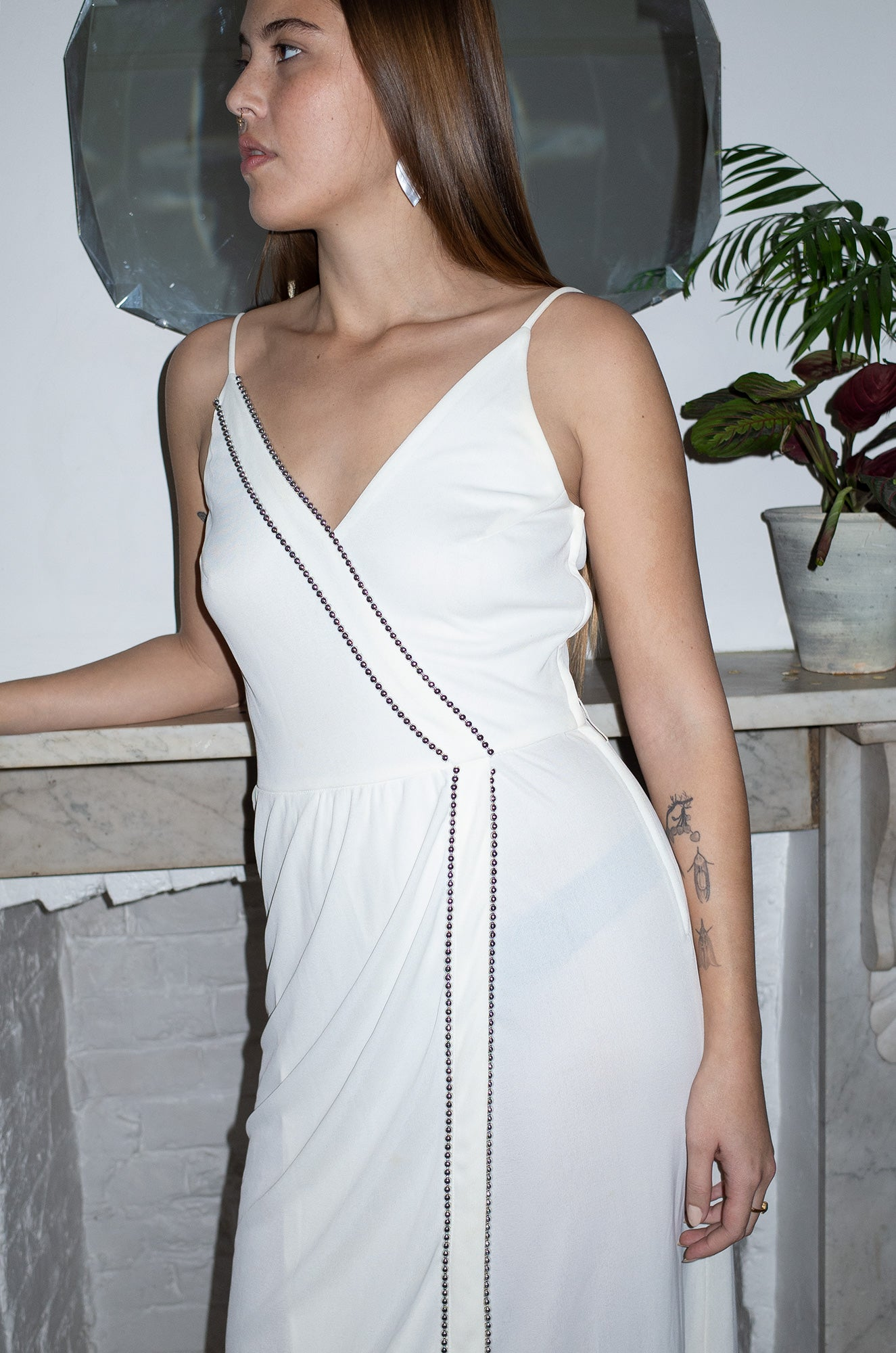 Model wears vintage white embellished midi dress by Human Sea Vintage