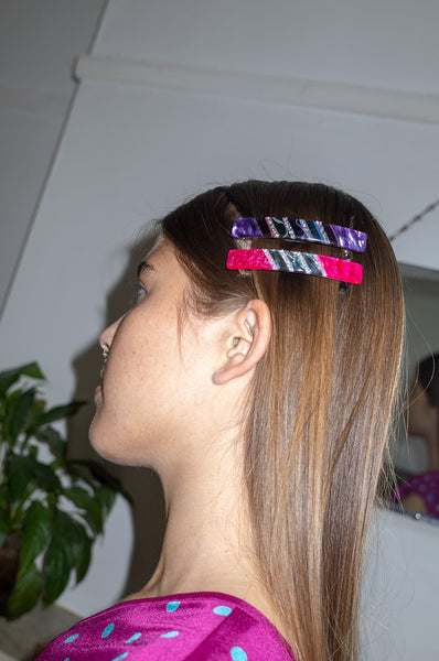 Model wears marbled acrylic barrettes by Human Sea Vintage