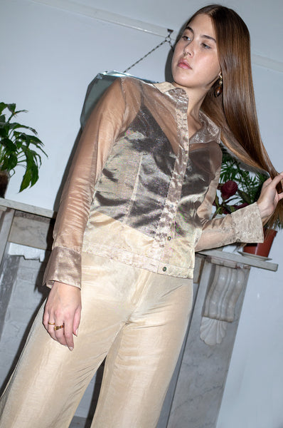 Model wears vintage 1990s gold sheer organza blouse by Gina Bacconi