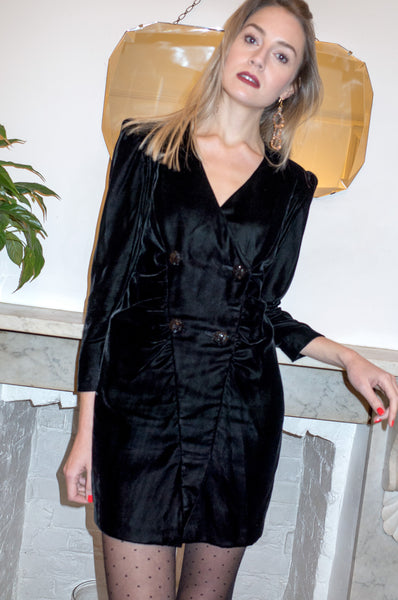 Model wears vintage 1980s black silk velvet long sleeve mini cocktail dress