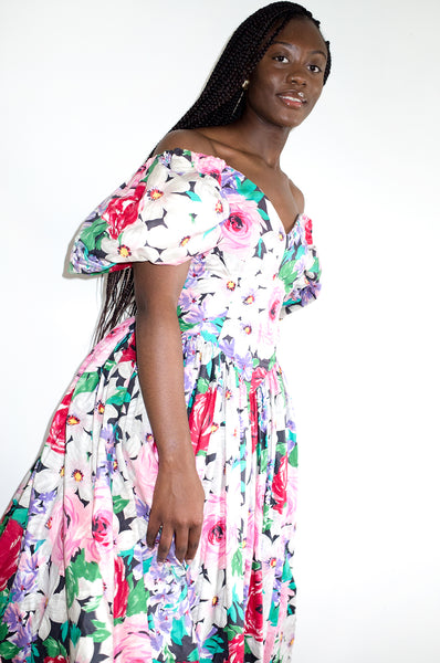 Model wears vintage 1980s Victor Costa floral print puff sleeve dress