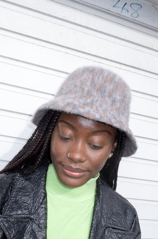 Model wears vintage Y2K bucket hat by Kangol