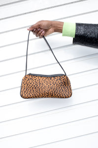 Vintage Y2K leopard-print shoulder bag with black strap and piping.