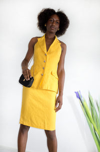 Vintage 1980s yellow designer two-piece with statement button detail