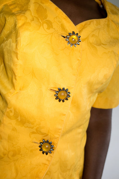 Button detail on Vintage 1980s bright yellow trophy jacket by Leslie Fay