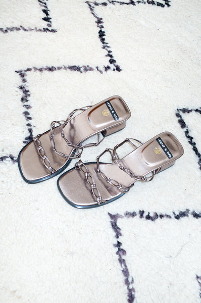 Vintage 1990s bronze metallic mules with chain-strap detailing