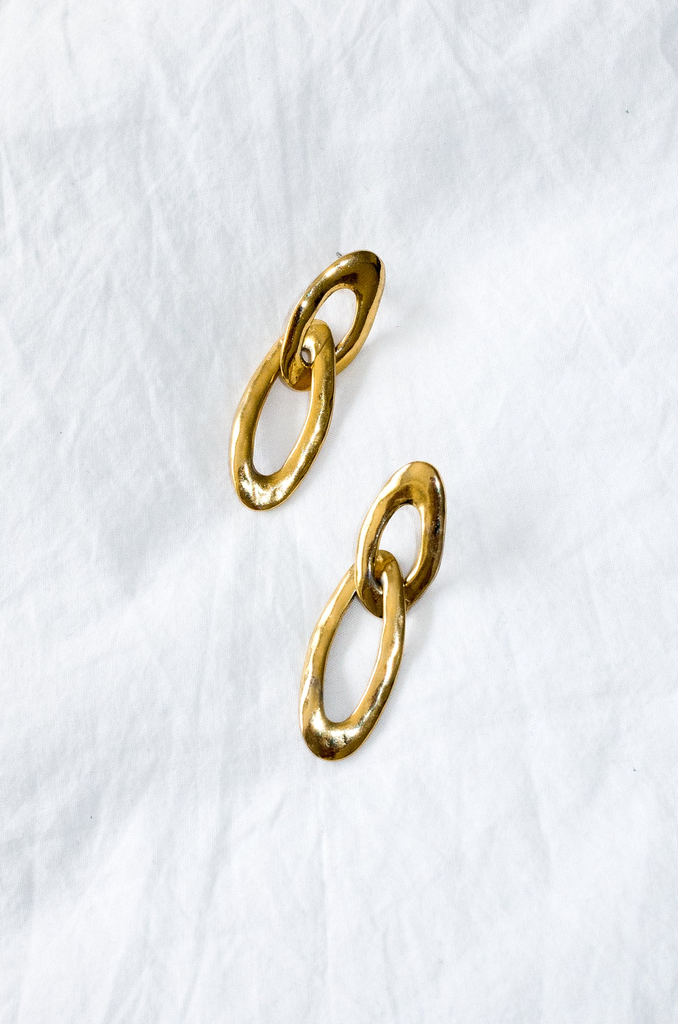 Vintage 1980s gold-tone earrings. Hammered effect.