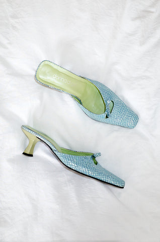 Vintage 1990s aqua mules with iridescent snakeskin effect and lime-green lining