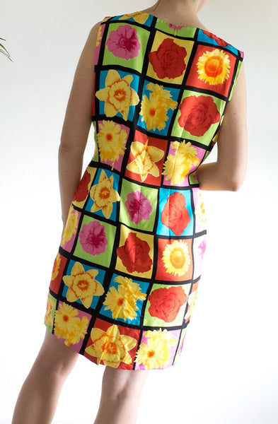 A statement vintage 1980s suit dress featuring a multicoloured Pop Art-inspired floral print