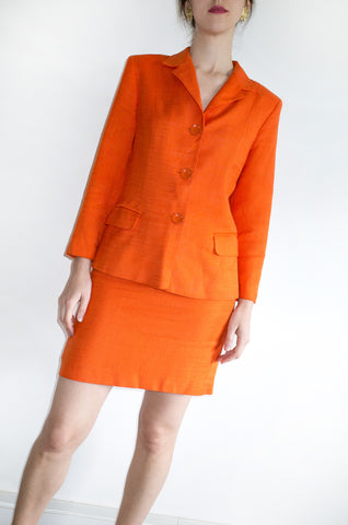 A vintage 1990s orange Italian designer skirt suit by C'est Comme Ca