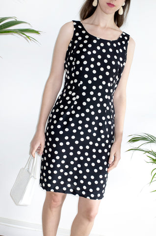 A chic vintage 1990s polka-dot sleeveless shift dress.