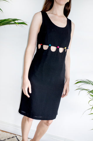 An unusual vintage 1990s black sleeveless shift dress with multicoloured buttons and cutaway detailing.
