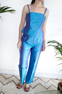 Woman wearing an iridescent 1990s vintage turquoise-blue party outfit by Austin Reed