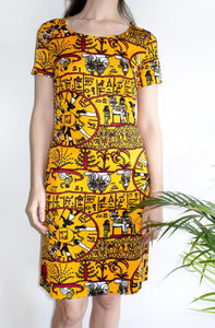 A rare vintage 1970s T-shirt dress featuring a novelty Egyptian hieroglyphics-inspired print.