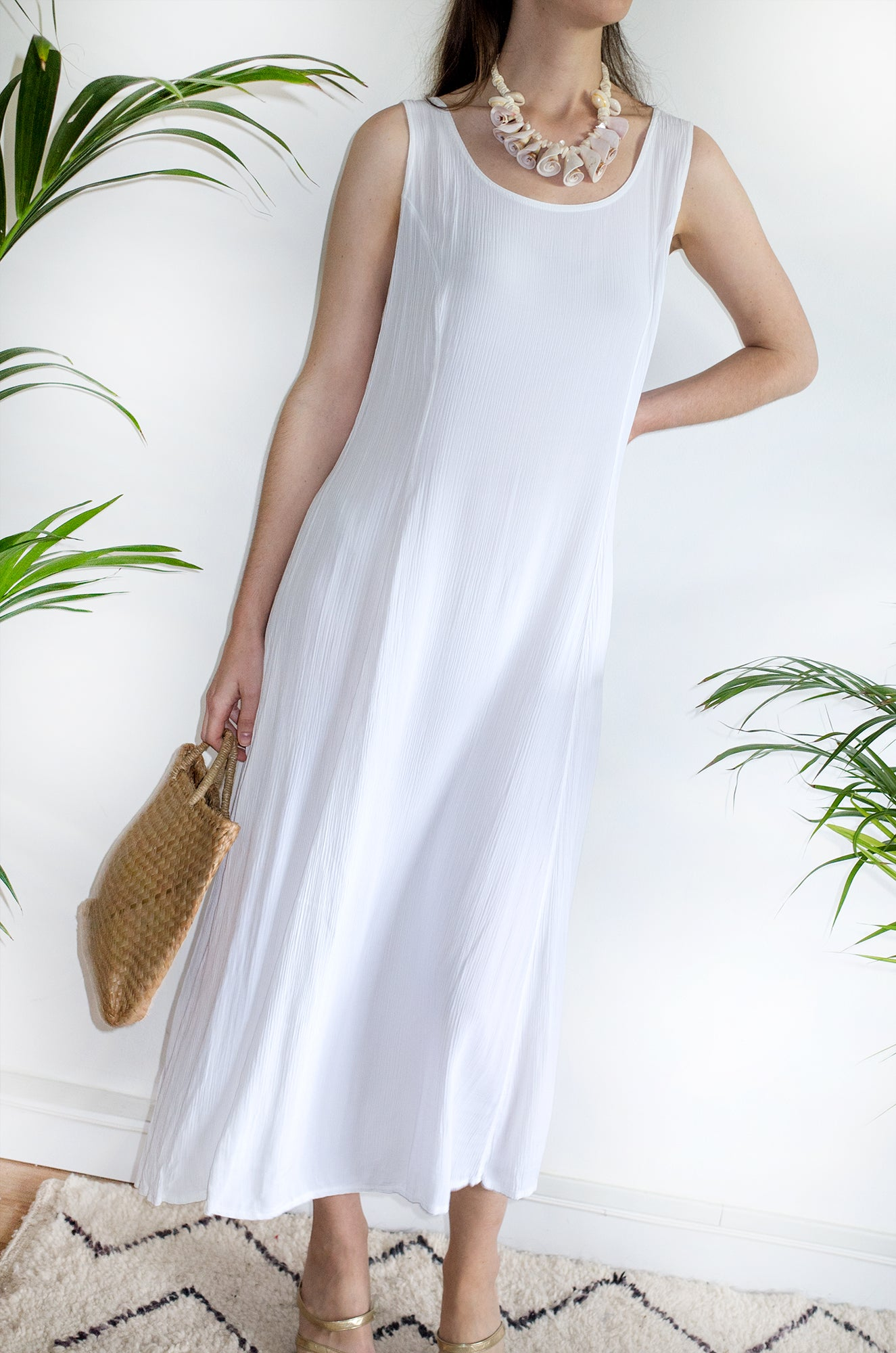 A vintage white sleeveless beach dress from 1994.