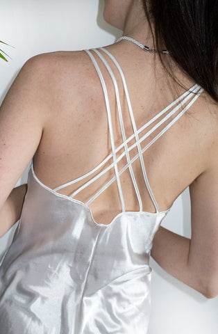 Back detail of a sleek 1990s vintage ivory lingerie teddy.