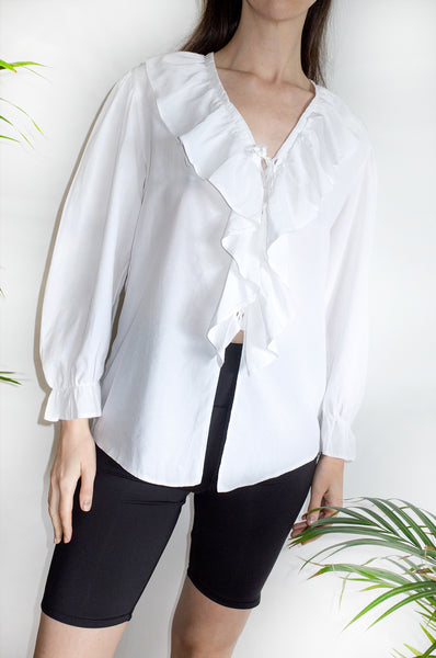 Woman wearing vintage 1980s white New Romantic blouse