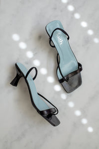 A pair of vintage 1990s sleek black slingback sandals with a baby blue insole