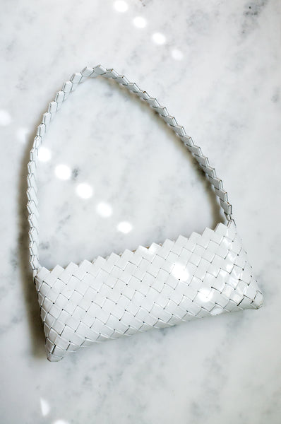 Vintage Y2K structured shoulder bag made from braided plastic in an origami style.