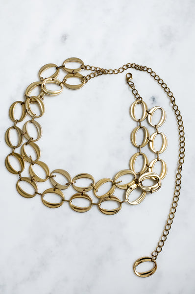 Vintage ring-detailed chain belt made from gold-tone metal.