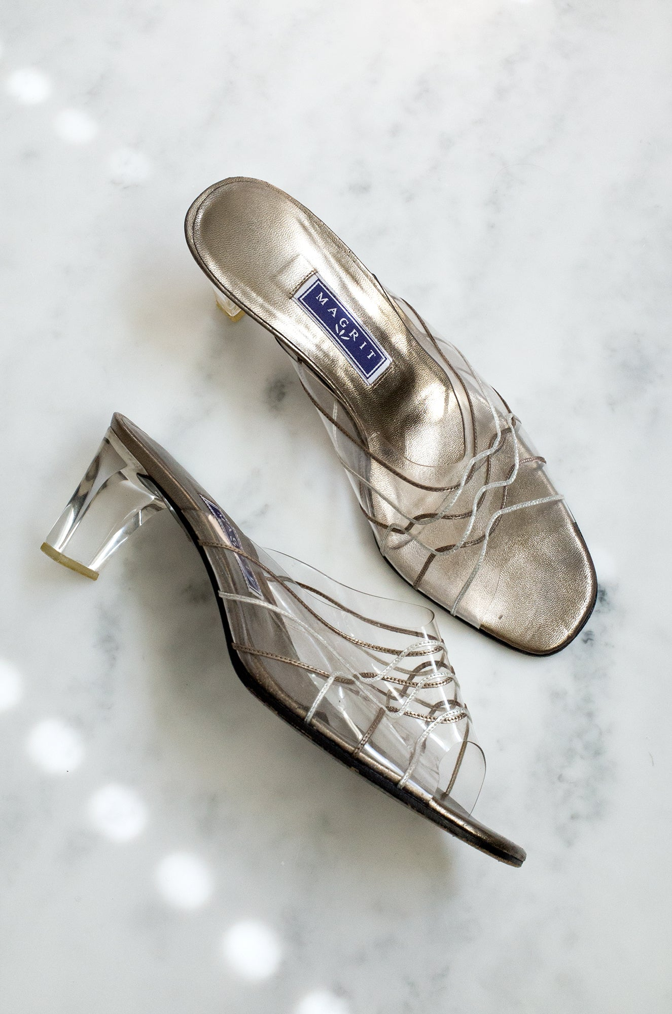 Vintage 1990s metallic and vinyl mules with wavy topstitching and a clear plexiglass heel.