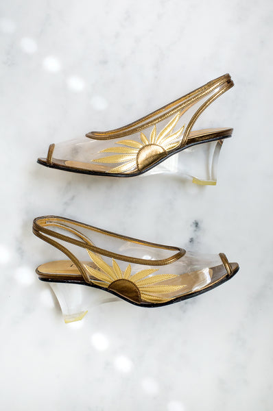 A stunning pair of vintage gold and bronze slingback shoes with sunflower detail and clear plexiglass heels by Libra shoes