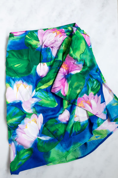 A vintage 1990s three-piece beachwear set with a Monet-inspired waterlily print.