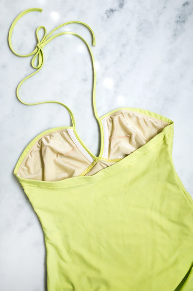 A vintage Y2K chartreuse one-piece swimsuit with halter-neck straps