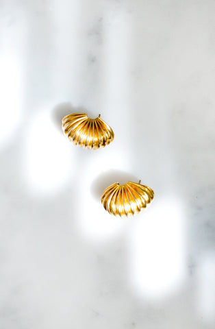 A pair of vintage 1980s gold-tone ridged earrings with stud fastening.