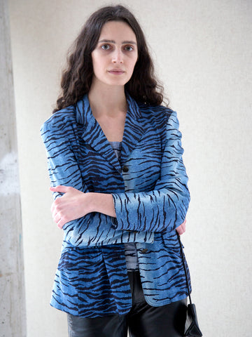 Model wearing vintage blue tiger-print single-breasted blazer
