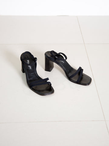 A pair of vintage 1990s minimalist black strappy sandals