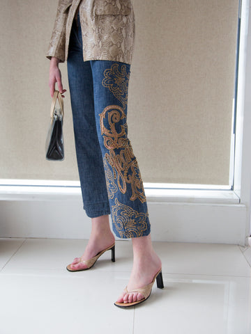 Vintage Y2K designer blue denim boot-cut jeans with cut-work and stunning gold logo embroidery by Christian Lacroix Jeans