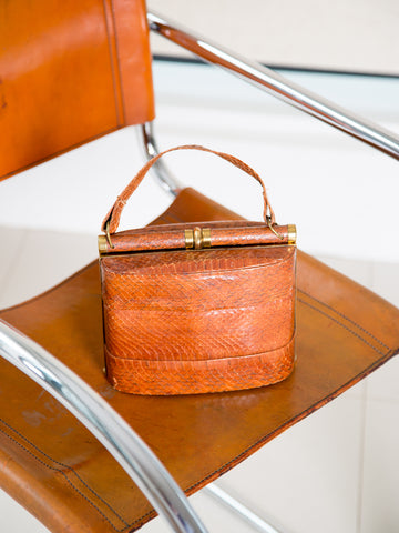 A vintage 1940s chestnut-brown handbag with brass hardware