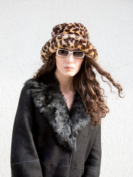 Model wearing a vintage 1990s leopard-print faux fur bucket hat