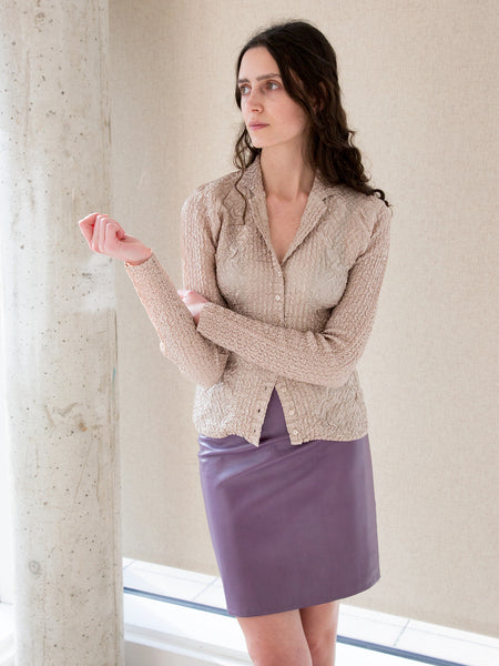 Woman wearing vintage purple leather skirt by Ungaro