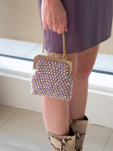 A vintage 1960s lilac handbag with gold-tone frame and strap