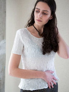 Model wearing vintage Y2K white scooped-neck short-sleeve top