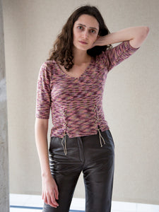 Model wearing vintage Y2K purple, mauve and sage green knitted top