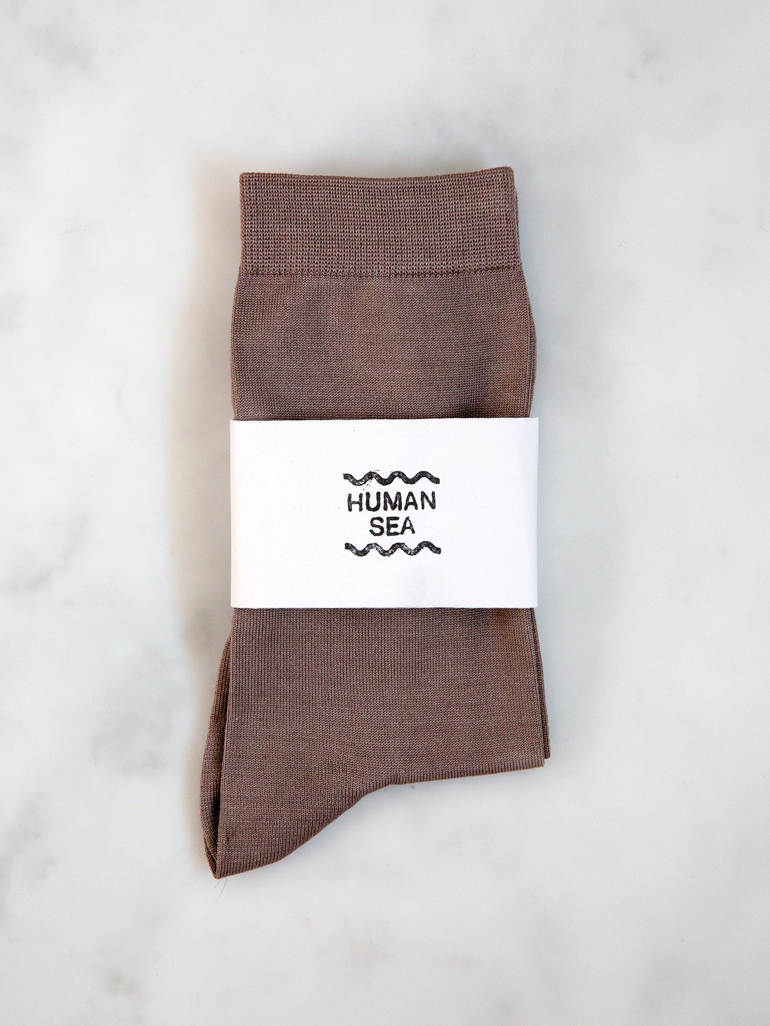 A pair of mauve socks from our exclusive collaboration with String Theory London.