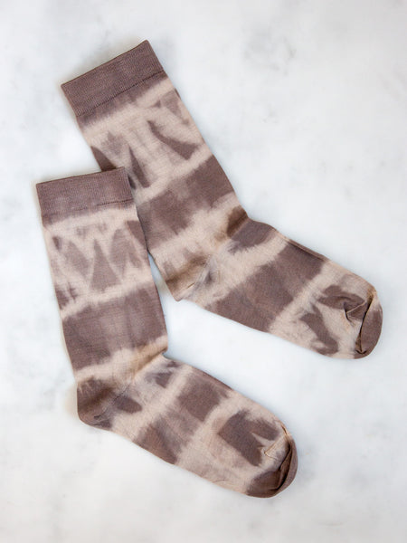 A pair of mauve tie-dye socks from our exclusive collaboration with String Theory London.
