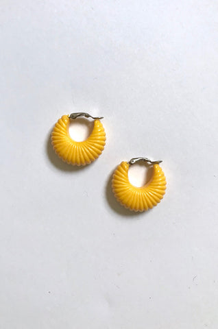 Yellow ridged clip-on hoops by Human Sea Vintage