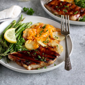 Brown Sugar Balsamic Pork Chops with Cheesy Grilled Potatoes