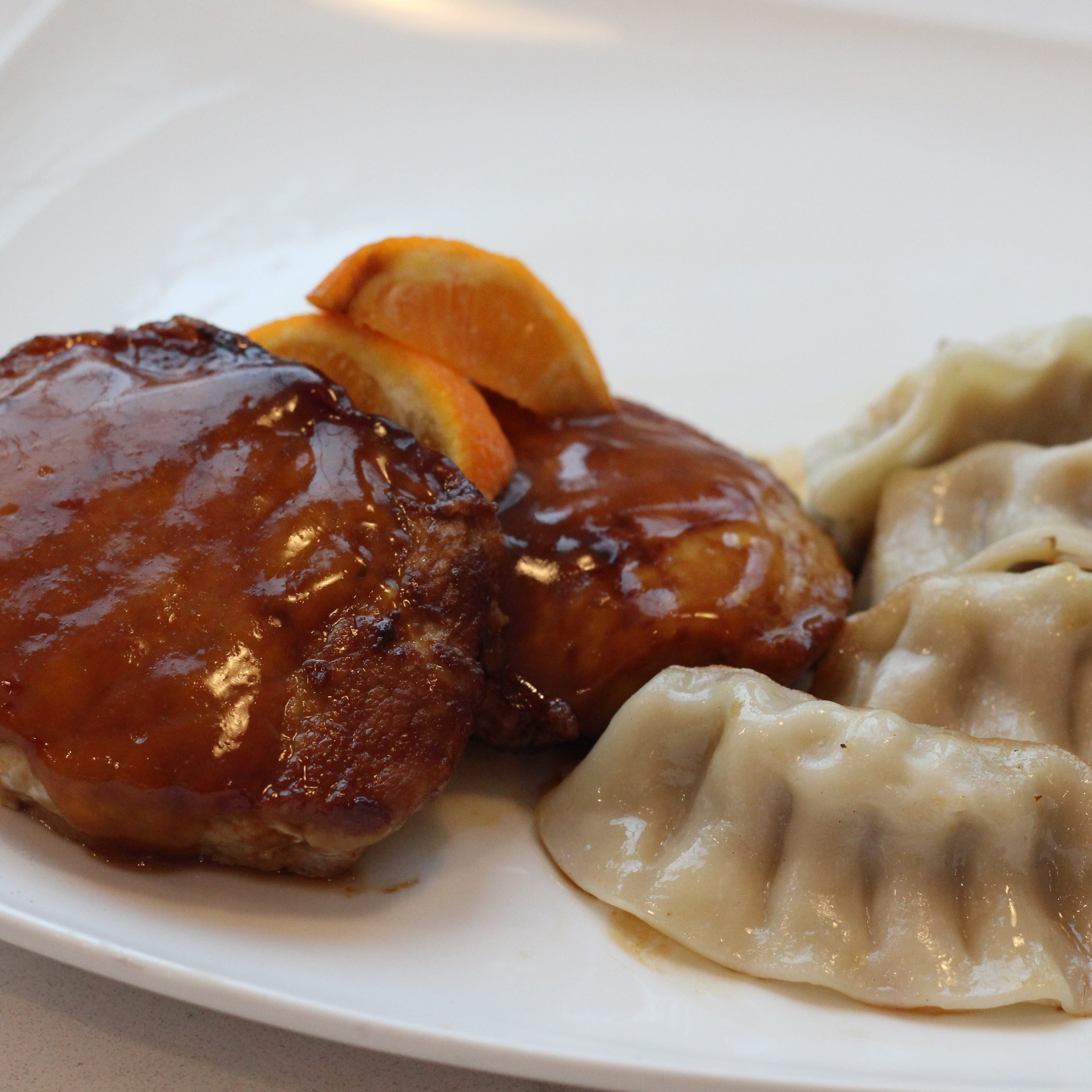Orange-Ginger Pork Chops with Dumplings