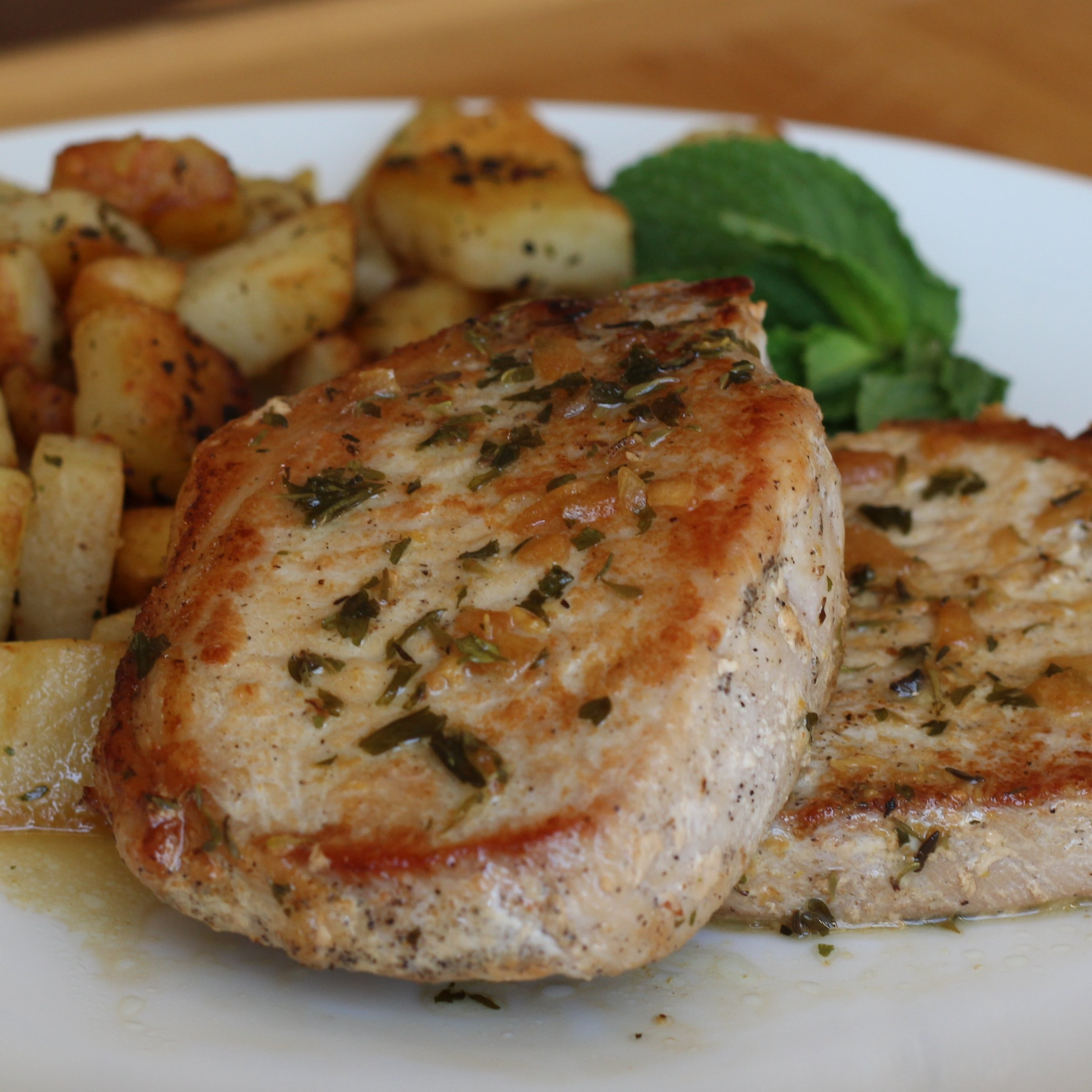 Pan-Seared Pork Chops with Herb Butter Sauce and Garlic Home Fries