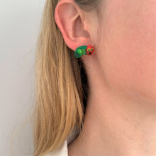 Caterpillars stud earrings by Heartbeat Handicrafts being worn on model's ear