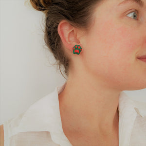 Christmas pawprint stud earrings on model