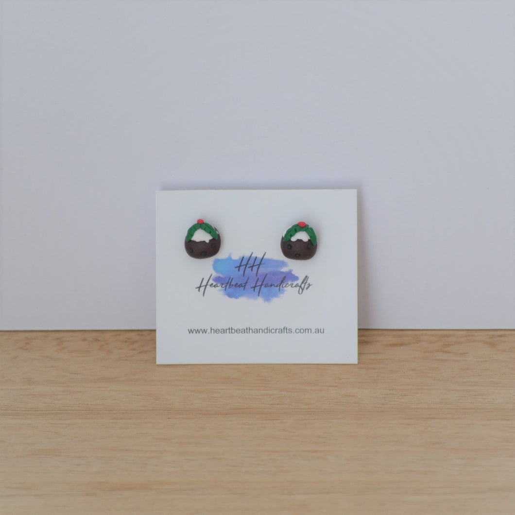 Christmas pudding studs on backing card on timber background